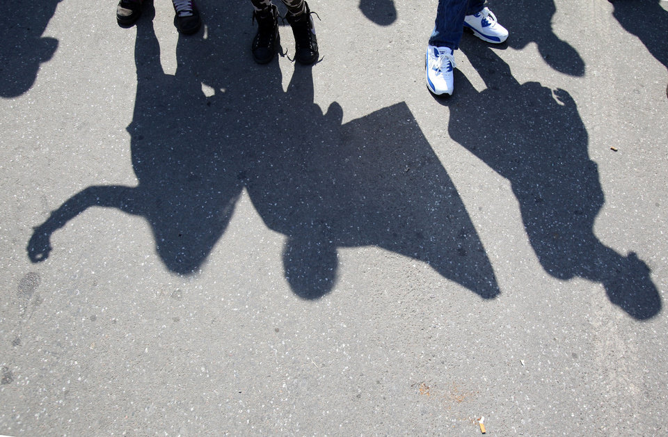 Photo - Shadows of protesters waving Serbian flags during the protest of Serbian nationalist organization Dveri, in Belgrade, Serbia, Sunday, April 21, 2013. Several hundred protesters gathered to protest against the recognition of Kosovo as an independent state. (AP Photo/Darko Vojinovic)