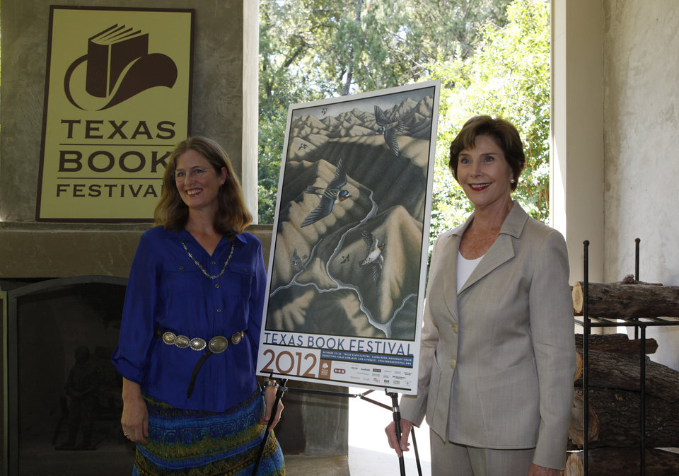 Photo -   Former first lady Laura Bush, right, and artist Margie Crisp posses with the poster that Crisp made for the 2012 Texas Book festival Wednesday, Sept. 12, 2012, at Bush's home in the Preston Hollow section of Dallas. Bush, who founded the festival when she was first lady of Texas, unveiled this year's book festival poster for the annual event in Austin. (AP Photo/LM Otero)