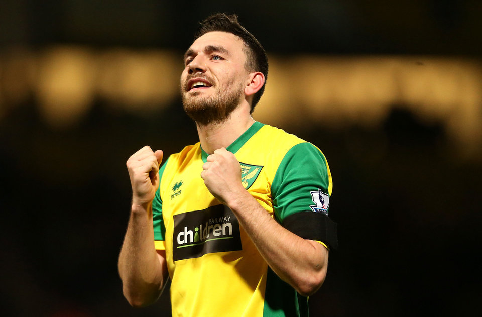 Photo - Norwich City's goal scorer Robert Snodgrass celebrates at the end of their Emglish Premier League soccer match against Tottenham Hotspur at Carrow Road, Norwich, England, Sunday, Feb. 23, 2014. (AP Photo/Stephen Pond, PA Wire)    UNITED KINGDOM OUT    -   NO SALES   -   NO ARCHIVES