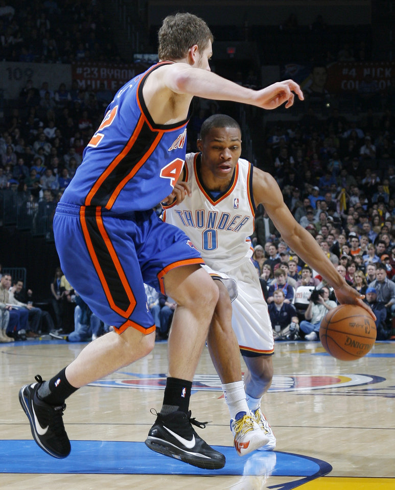 Oklahoma City's Russell Westbrook (0) dribbles as David Lee (42) of New York defends during the NBA basketball game between the Oklahoma City Thunder and the New York Knicks at the Ford Center in Oklahoma City, January 11, 2010. Photo by Nate Billings, The Oklahoman