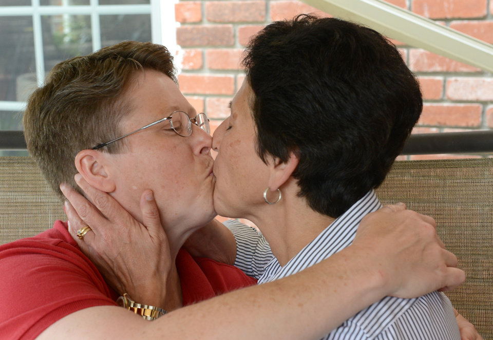 Photo - Deb, left, and Susan Whitewood celebrate with a kiss at their home in South Fayette, Pa., Tuesday, May 20, 2014, after a federal judge overturned the state's ban on gay marriage.  (AP Photo/Pittsburgh Post-Gazette, Bob Donaldson)  MAGS OUT; NO SALES; MONESSEN OUT; KITTANNING OUT; CONNELLSVILLE OUT; GREENSBURG OUT; TARENTUM OUT; NORTH HILLS NEWS RECORD OUT; BUTLER OUT