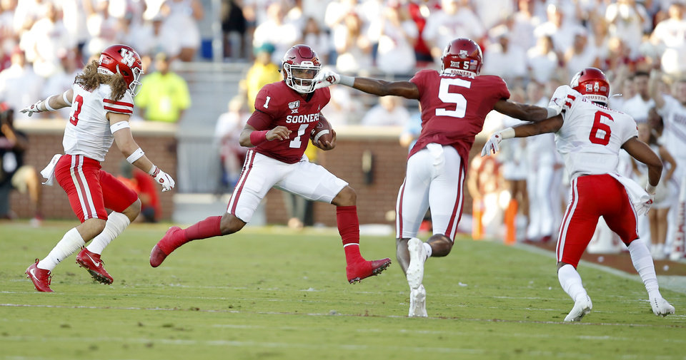 Photo - Oklahoma's Jalen Hurts (1) runs during a college football game between the University of Oklahoma Sooners (OU) and the Houston Cougars at Gaylord Family-Oklahoma Memorial Stadium in Norman, Okla., Sunday, Sept. 1, 2019. Oklahoma won 49-31. [Bryan Terry/The Oklahoman]