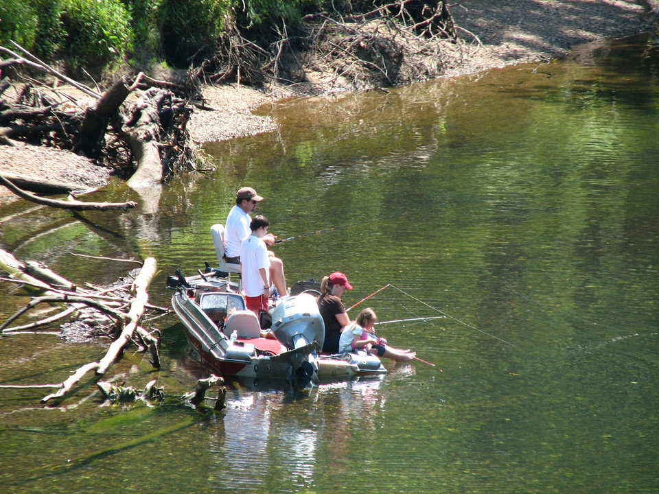 Photo - A family tries their luck fishing for trout on the White River below the Beaver Lake Dam in northwest Arkansas. PHOTO BY ED GODFREY, THE OKLAHOMAN