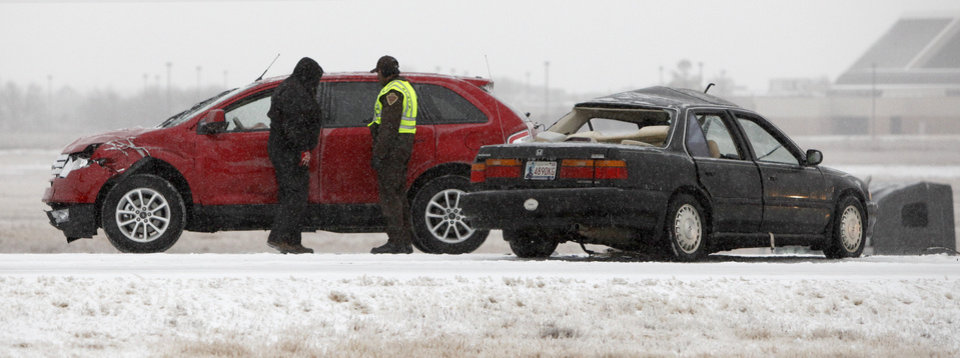 Authorities work the scene of an accident on the Kilpatrick Turnpike at MacArthur Boulevard in Oklahoma City, Thursday, Jan. 28, 2010.  Photo by Bryan Terry, The Oklahoman