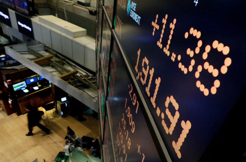 Photo - A board above the trading floor of the New York Stock Exchange shows the closing number for the Standard & Poor's index, Tuesday, May 27, 2014. The S&P 500 gained 11 points, or 0.6 percent, to close at 1,911 Tuesday. It had its first close above 1,900 points on Friday.  (AP Photo/Richard Drew)