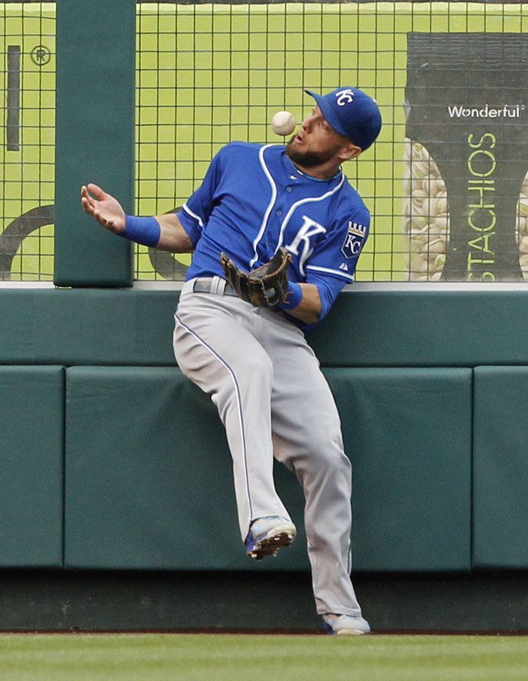 Photo - Kansas City Royals left fielder Alex Gordon bobbles a ball hit by Los Angeles Angels' Albert Pujols in the fifth inning of a baseball game Saturday, May 24, 2014, in Anaheim, Calif. After video review, it was ruled a double, and is the 2,400th hit of Pujols' career. (AP Photo/Alex Gallardo)
