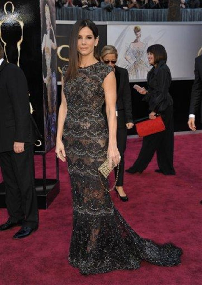 Photo - Actress Sandra Bullock arrives at the Oscars at the Dolby Theatre on Sunday Feb. 24, 2013, in Los Angeles. (Photo by John Shearer/Invision/AP)