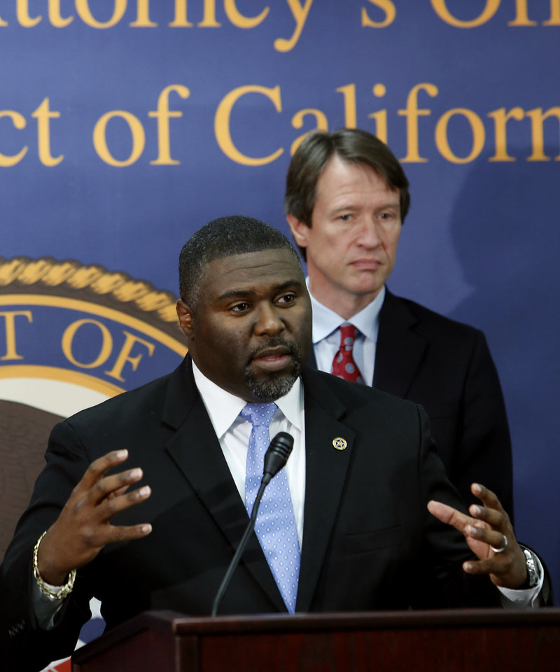 Photo - Dr. Gregory Campbell Jr, deputy chief inspector for Western Field Operations, left, discusses the federal crackdown on the surge of thefts from mailboxes across the Central Valley, during a news conference in Sacramento, Calif.,  Wednesday, Jan. 15, 2014.  Working with postal investigators and local law enforcement, at least 27 people have been charged with crimes related to the break-in of mailboxes in post offices lobbies, neighborhood mailboxes, postal trucks and the counterfeiting of postal keys in search of checks, credit cards, personal identifying information and prescription drugs deviled by mail. At right is Benjamin Wagner, the United States Attorney for the Eastern District of California.(AP Photo/Rich Pedroncelli)