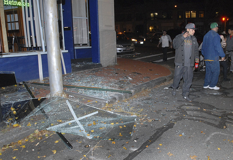 Photo -   Glass and debris litter a street after a nearby building was leveled by an explosion Friday, Nov. 23, 2012 in downtown Springfield, Mass. (AP Photo/Springfield Republican, David Molnar) MANDATORY CREDIT