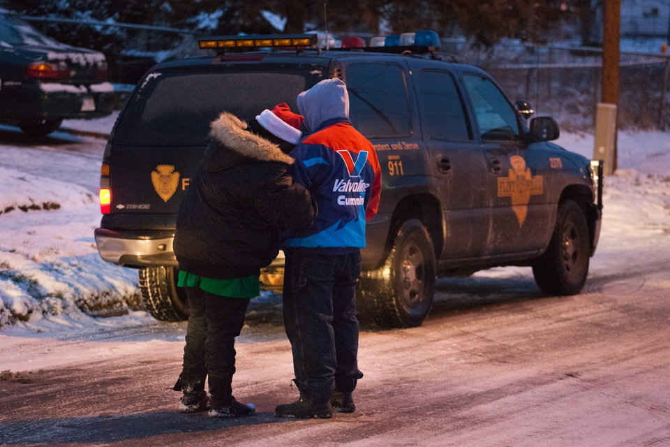Caroline Broach, left, and boyfriend Jerry Ormond console each other, Tuesday, Dec. 25, 2012 in Flint, Mich. Authorities say five people are dead in two separate incidents of what is believed to be accidental carbon monoxide poisoning. (AP Photo/Flint Journal, Griffin Moores)