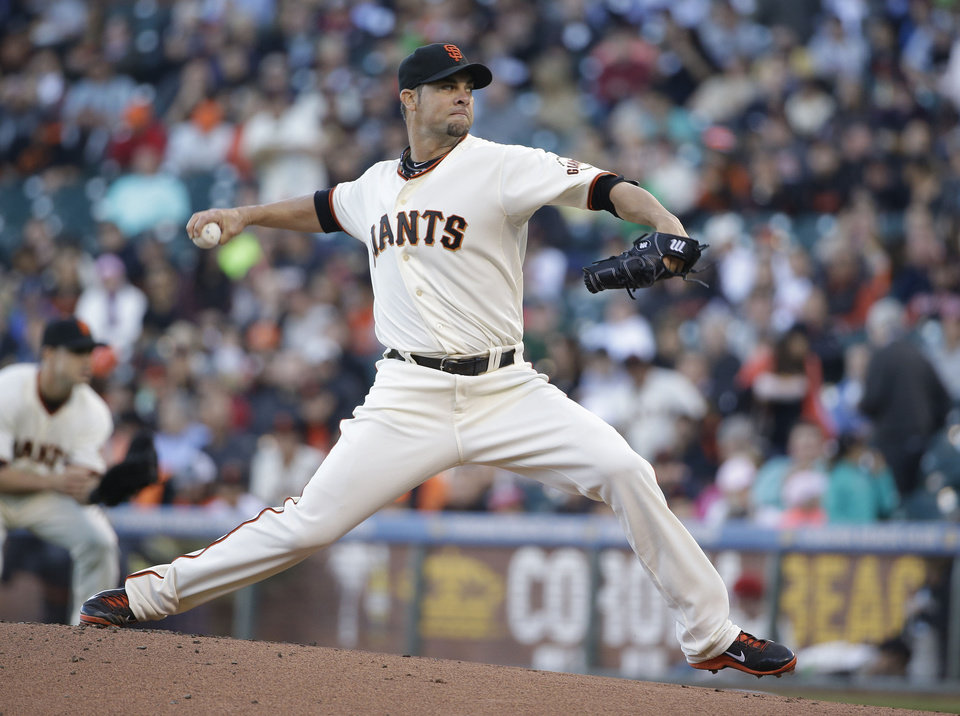 Photo - San Francisco Giants starting pitcher Ryan Vogelsong throws against the Cincinnati Reds in the first inning of their baseball game Thursday, June 26, 2014, in San Francisco. (AP Photo/Eric Risberg)