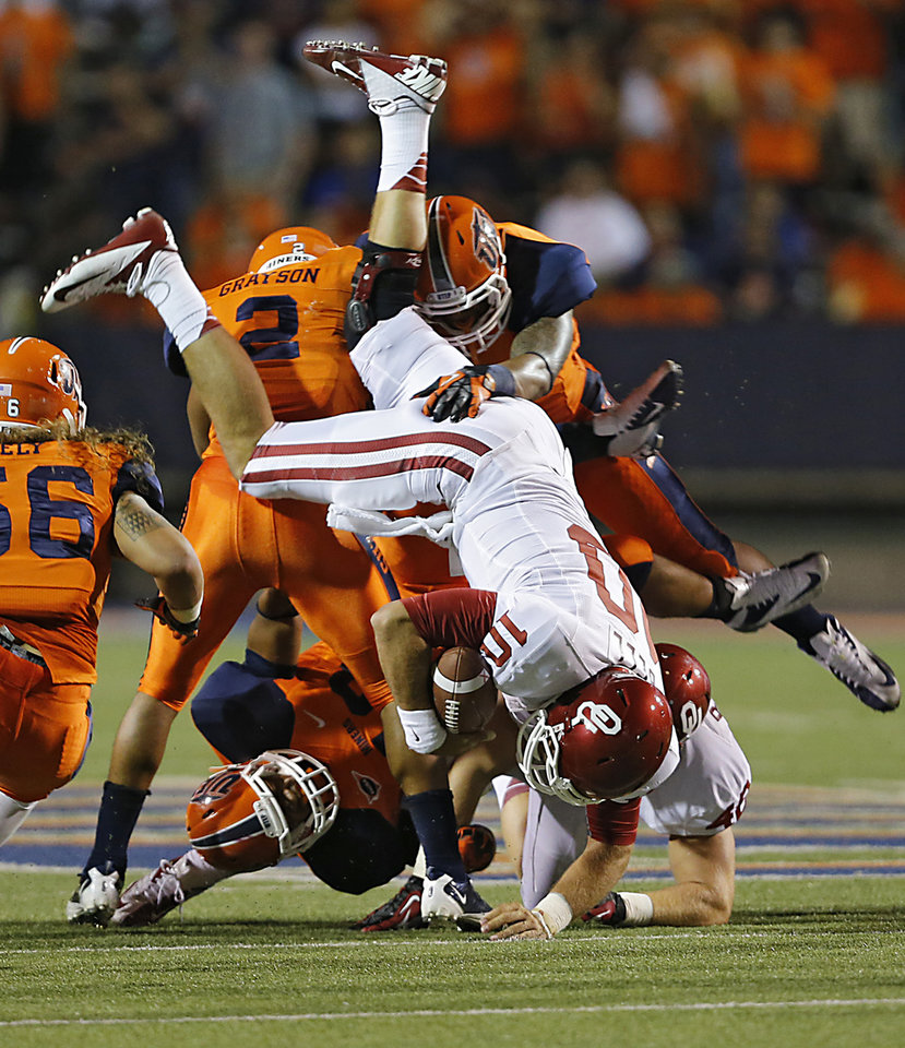 Oklahoma Sooners quarterback Blake Bell (10) is upended by the UTEP defense during the college football game between the University of Oklahoma Sooners (OU) and the University of Texas El Paso Miners (UTEP) at Sun Bowl Stadium on Saturday, Sept. 1, 2012, in El Paso, Tex.  Photo by Chris Landsberger, The Oklahoman