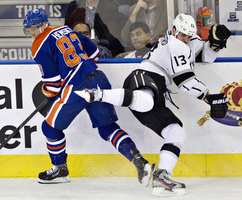 Los Angeles Kings' Kyle Clifford (13) misses the hit on Edmonton Oilers' Ales Hemsky during the first period of their NHL hockey game, Tuesday, Feb. 19, 2013, in Edmonton, Alberta. (AP Photo/The Canadian Press, Jason Franson)