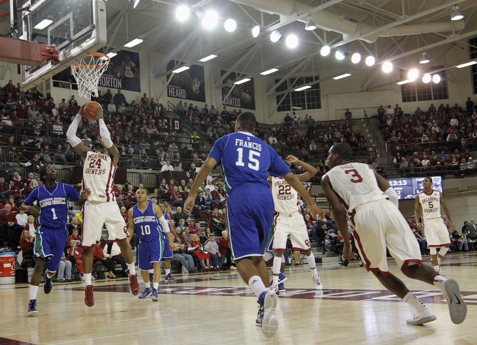 OU: Oklahoma's Romero Osby (24) shoots during a college basketball game between the University of Oklahoma and Texas A&M Corpus Christi at McCasland Field House in Norman, Okla., Monday, Dec. 31, 2012.  Photo by Garett Fisbeck, For The Oklahoman