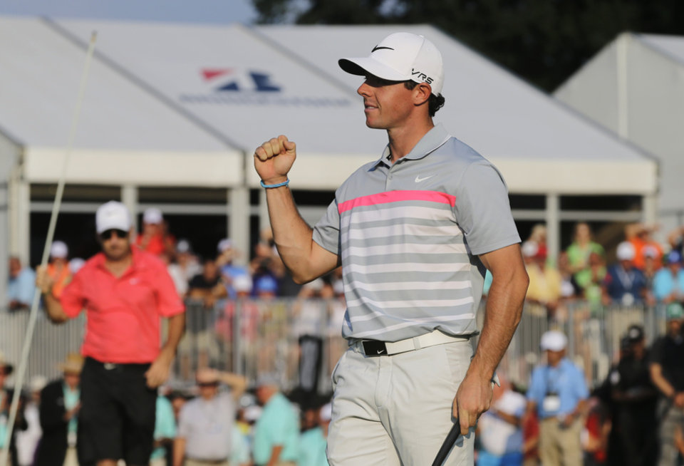 Photo - Rory McIlroy celebrates after winning the Bridgestone Invitational golf tournament Sunday, Aug. 3, 2014, at Firestone Country Club in Akron, Ohio. McIlroy's 15-under par total beat runner up Sergio Garcia by two shots. (AP Photo/Mark Duncan)