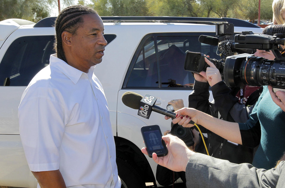 Photo - Arizona Cardinals defensive coordinator Ray Horton speaks with the media outside the team's NFL football training facility, Wednesday, Jan. 2, 2013, in Tempe, Ariz., after his first interview for the teams' vacant head coach position. Former head coach Ken Whisenhunt was relieved of duties last week. (AP Photo/Matt York)