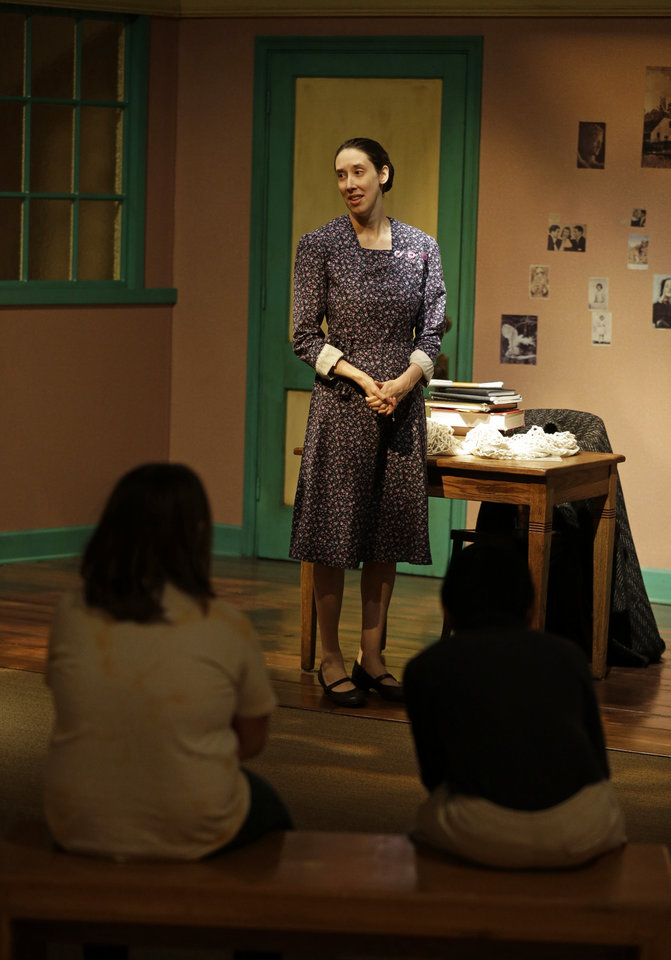 In this Monday, March 18, 2013 photo, actress Julie Mauro portrays Miep Gies, one of Anne Frank's protectors and the woman who preserved her diary, during a performance in an Anne Frank exhibition at the Indianapolis Children\'s Museum in Indianapolis. Eleven saplings grown from seeds taken from the massive chestnut tree that stood outside the home in which Frank and her family hid are being distributed to museums, schools, parks and Holocaust remembrance centers through a project led by The Anne Frank Center USA. (AP Photo/Michael Conroy) (AP Photo/Michael Conroy)