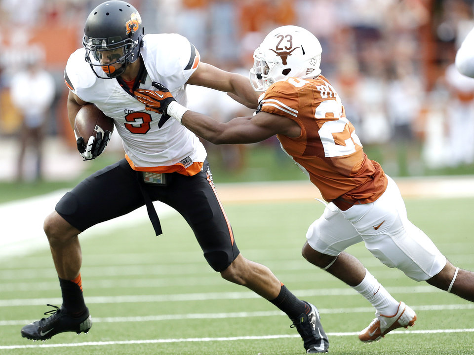 Oklahoma State\'s Marcell Ateman (3) tries to get by UT\'s Carrington Byndom (23) during a college football game between the Oklahoma State University Cowboys (OSU) and the University of Texas Longhorns (UT) at Darrell K Royal - Texas Memorial Stadium in Austin, Texas, Saturday, Nov. 16, 2013. Photo by Sarah Phipps The Oklahoman
