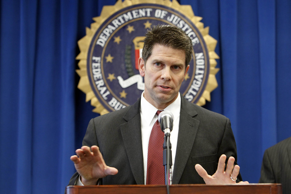 Photo -   David Bowdich, special agent in charge of the FBI's L.A. area counterterrorism unit, discusses the arrests of four men suspected of promoting terrorist activities in counties east of Los Angeles, at a news conference at FBI headquarters in Los Angeles Tuesday, Nov. 20, 2012. (AP Photo/Reed Saxon)
