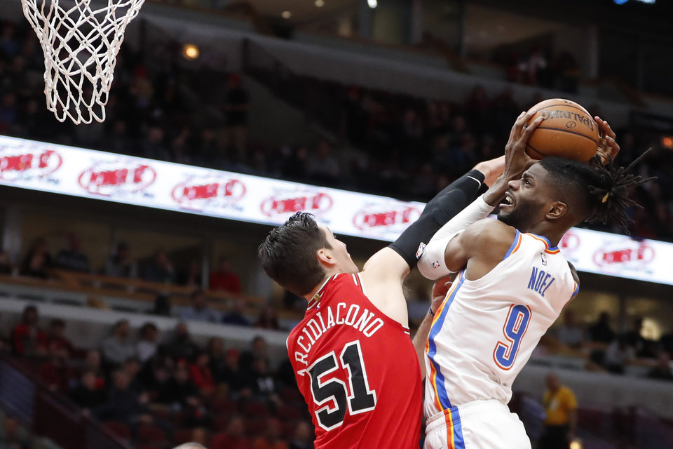 Photo - Chicago Bulls' Ryan Arcidiacono (51) fouls Oklahoma City Thunder's Nerlens Noel during the first half of an NBA basketball game Tuesday, Feb. 25, 2020, in Chicago. (AP Photo/Charles Rex Arbogast)