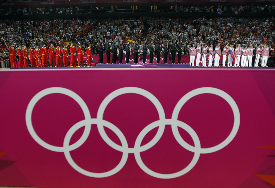 Men's basketball team members from Spain, USA and Russia receiver their medals at the 2012 Summer Olympics, Sunday, Aug. 12, 2012, in London. (AP Photo/Charles Krupa)