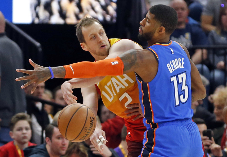 Photo - Oklahoma City Thunder forward Paul George (13) guards against Utah Jazz forward Joe Ingles (2) in the first half during an NBA basketball game Monday, March 11, 2019, in Kearns, Utah. (AP Photo/Rick Bowmer)