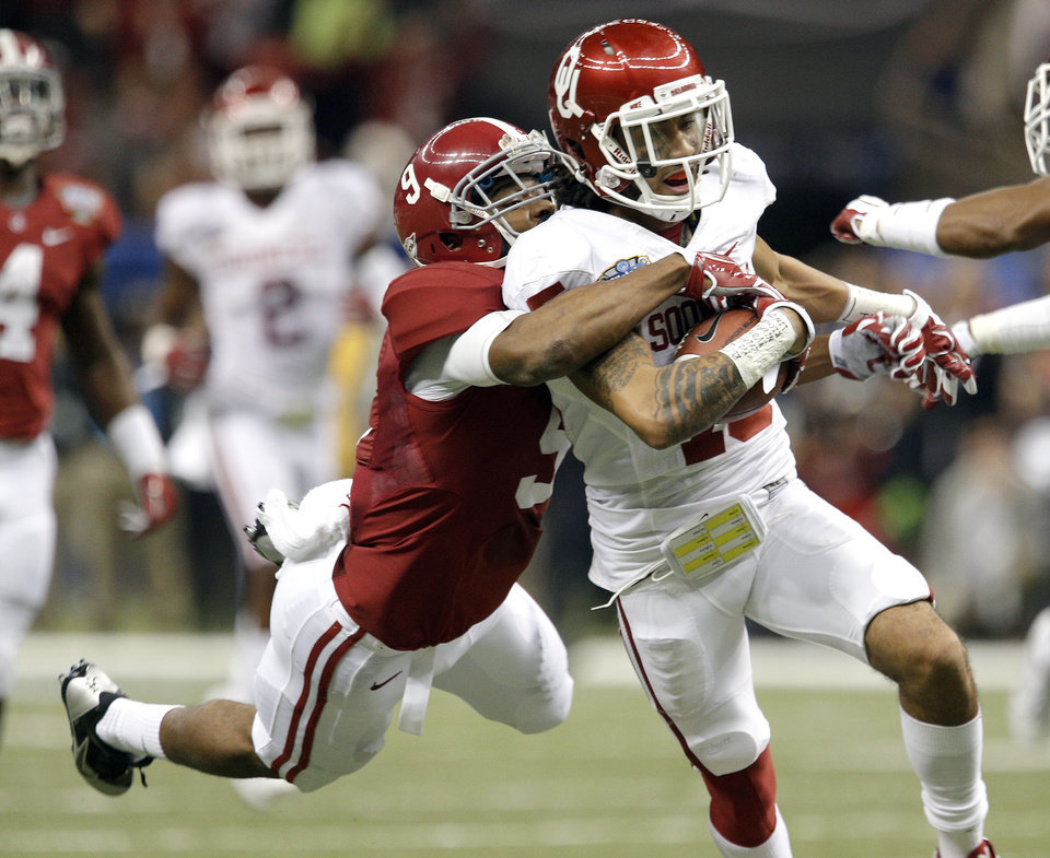 Photo - Oklahoma's Zack Sanchez (15) returns a interception as he is tackle by Alabama's Amari Cooper (9) during the NCAA football BCS Sugar Bowl game between the University of Oklahoma Sooners (OU) and the University of Alabama Crimson Tide (UA) at the Superdome in New Orleans, La., Thursday, Jan. 2, 2014.  .Photo by Sarah Phipps, The Oklahoman