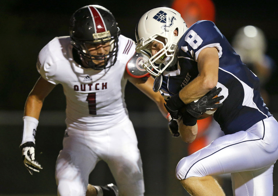 Photo - Casady's Mack Jensen scores a touchdown past Holland Hall's Pierce Brady during their high school football game at Casady in Oklahoma City, Friday, August 30, 2013. Photo by Bryan Terry, The Oklahoman