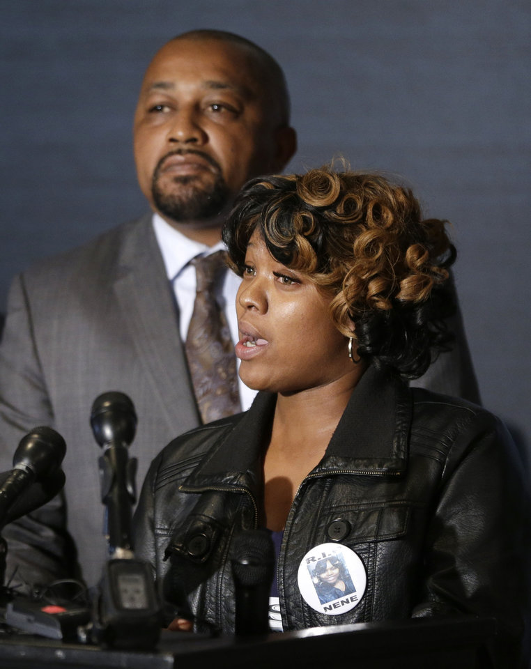 Photo - Monica McBride and Walter Ray Simmons, the parents of Renisha McBride address the media during a news conference in Southfield, Mich., Friday, Nov. 15, 2013. Their daughter was shot on Nov. 2  in the face on Theodore P. Wafer's front porch in Dearborn Heights. (AP Photo/Carlos Osorio)