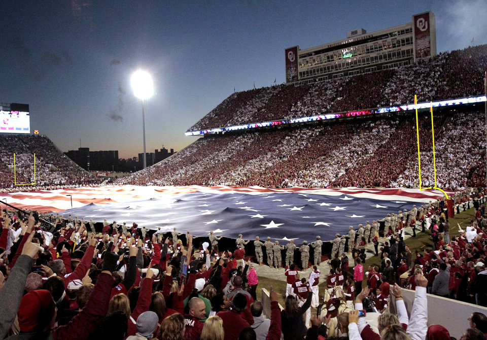 Fans wearing alternating red and white and a football field sized American Flag were part of the pre game scene of the college football game between the University of Oklahoma Sooners (OU) and the Fighting Irish of Notre Dame (ND) at Gaylord Family-Oklahoma Memorial Stadium in Norman, Okla., on Saturday, Oct. 27, 2012. Photo by Steve Sisney, The Oklahoman