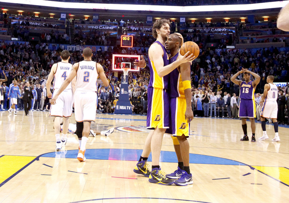 Photo - Lakers' Pau Gasol (16) and Kobe Bryant (24) celebrate the Lakers' win as Oklahoma City's Nick Collison (4) and Thabo Sefolosha (2) walk off the court during the NBA basketball game between the Oklahoma City Thunder and the Los Angeles Lakers, Sunday, Feb. 27, 2011, at the Oklahoma City Arena.Photo by Sarah Phipps, The Oklahoman