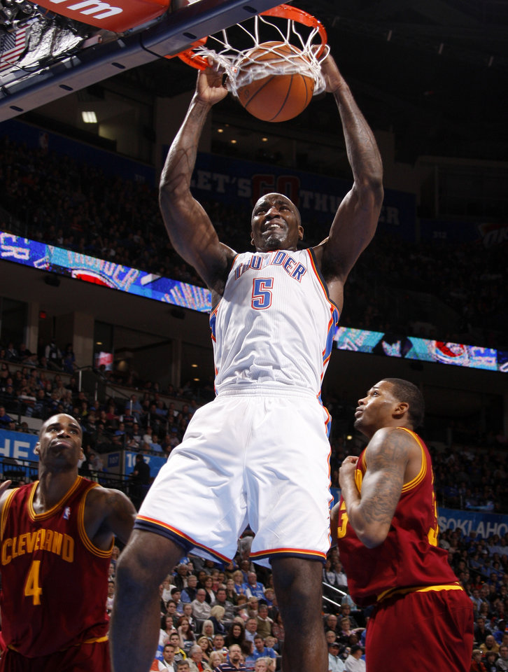 Photo - Oklahoma City's Kendrick Perkins (5) dunks the ball between Cleveland's Antawn Jamison (4) and Alonzo Gee (33) during the NBA basketball game between the Oklahoma City Thunder and the Cleveland Cavaliers at Chesapeake Energy Arena in Oklahoma City, Friday, March 9, 2012. Photo by Bryan Terry, The Oklahoman