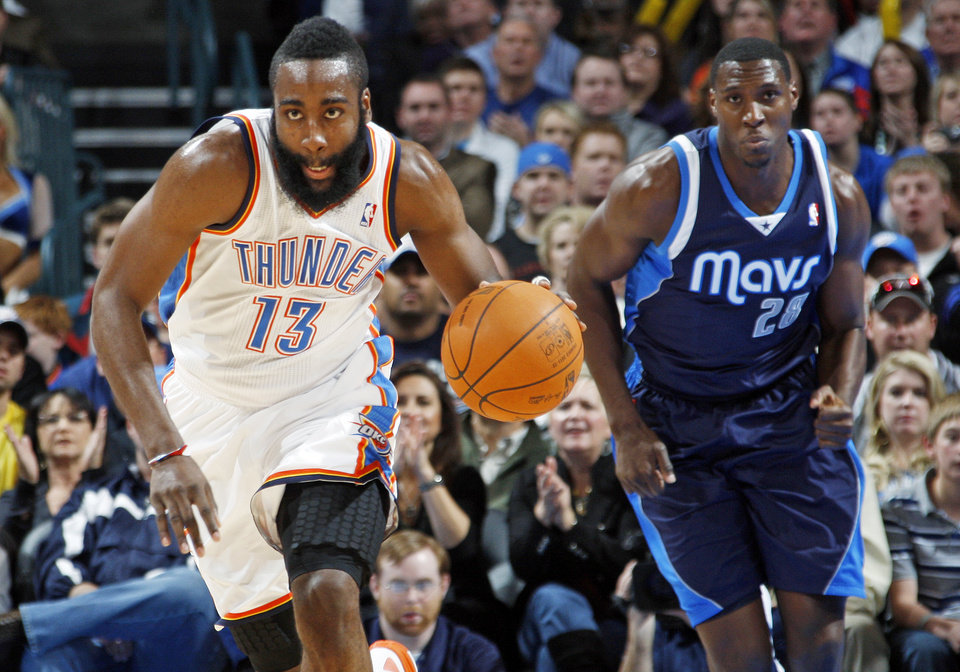 Oklahoma City's James Harden (13) takes the ball on a fast break in front of Ian Mahinmi (28) of Dallas in the first half of an NBA basketball game between the Oklahoma City Thunder and the Dallas Mavericks at Chesapeake Energy Arena in Oklahoma City, Thursday, Dec. 29, 2011. Photo by Nate Billings, The Oklahoman