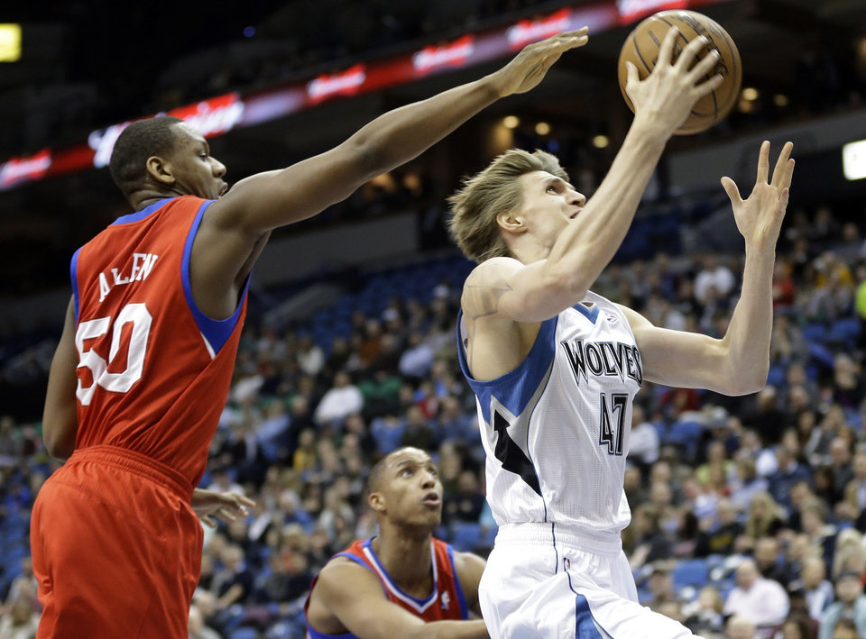 Photo - Minnesota Timberwolves' Andrei Kirilenko, right, of Russia, lays up a shot as Philadelphia 76ers' Lavoy Allen, left, defends and Evan Turner watches during the first quarter of an NBA basketball game Wednesday, Feb. 20, 2013, in Minneapolis. (AP Photo/Jim Mone)