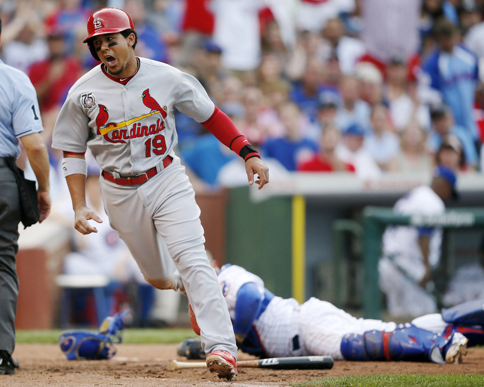 Photo - St. Louis Cardinals' Jon Jay reacts after scoring past Chicago Cubs catcher Welington Castillo, rear, during the seventh inning of a baseball game on Saturday, July 26, 2014, in Chicago. (AP Photo/Andrew A. Nelles)