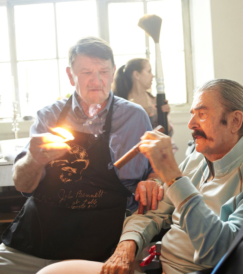 Photo - JB lights a cigar for LeRoy Neiman at the artist's 90th birthday party, which Bennett catered.