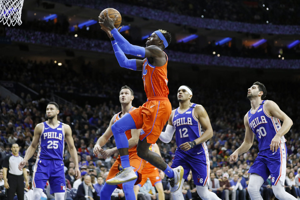 Photo - Oklahoma City Thunder's Dennis Schroder (17) got sup for a shot during the first half of an NBA basketball game against the Philadelphia 76ers, Monday, Jan. 6, 2020, in Philadelphia. (AP Photo/Matt Slocum)