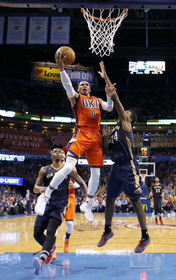 Photo - Oklahoma City's Russell Westbrook (0) goes to the basket as New Orleans' Solomon Hill (44) defends during the NBA game between the Oklahoma City Thunder and the New Orleans Pelicans at the Chesapeake Energy Arena,  Sunday, Dec. 4, 2016. Photo by Sarah Phipps, The Oklahoman