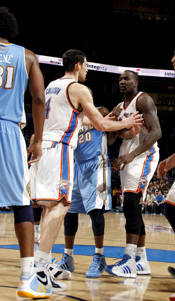 Oklahoma City's Nick Collison (4) holds back Kendrick Perkins (5) after a push from Denver's Nen