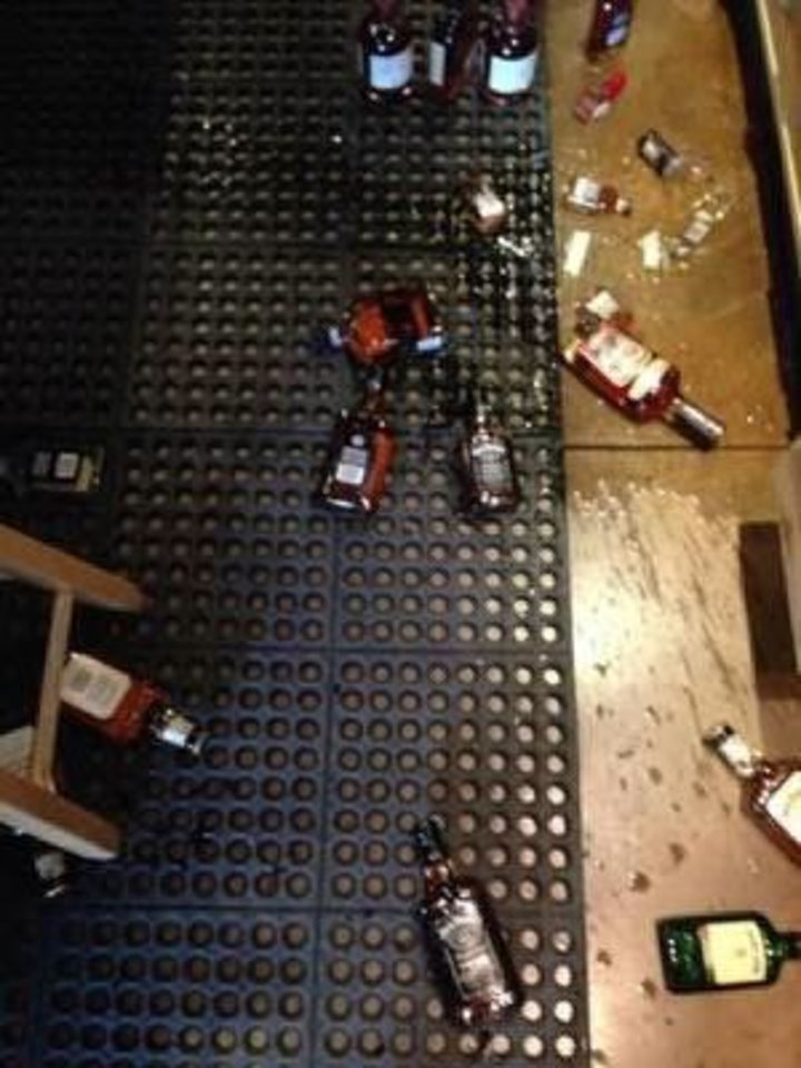 Broken bottles are on the floor of Edmond Wine Shop in Edmond after 4.5-magnitude earthquake shook the Oklahoma City metro area shortly after noon Saturday. <strong>PHOTO PROVIDED</strong>