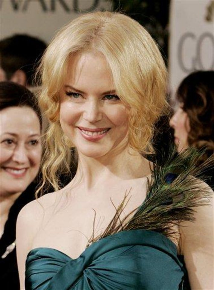 "**FILE**Nicole Kidman arrives for the 62nd Annual Golden Globe Awards on  Jan. 16, 2005, in Beverly Hills, Calif. An Australian judge said Friday, Feb.11, 2005, that Kidman and two freelance photographers accused of stalking the Oscar-winning actress should try to resolve their problems out of court like ""intelligent people.""  (AP Photo/Kevork Djansezian)"