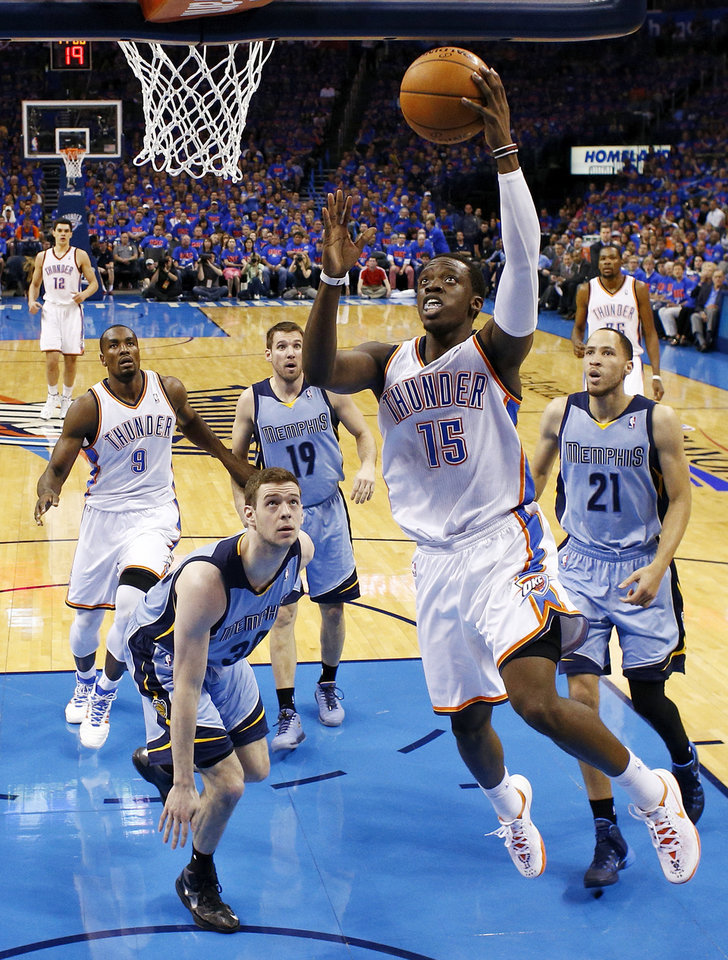 Photo - Oklahoma City's Reggie Jackson (15) takes the ball to the hoop during Game 7 in the first round of the NBA playoffs between the Oklahoma City Thunder and the Memphis Grizzlies at Chesapeake Energy Arena in Oklahoma City, Saturday, May 3, 2014. The Thunder won 120-109. Photo by Nate Billings, The Oklahoman