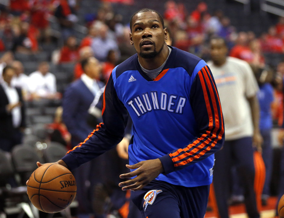 Photo - Oklahoma City's Kevin Durant (35) warms up before Game 3 of the Western Conference semifinals in the NBA playoffs between the Oklahoma City Thunder and the Los Angeles Clippers at the Staples Center in Los Angeles, Friday, May 9, 2014. Photo by Nate Billings, The Oklahoman