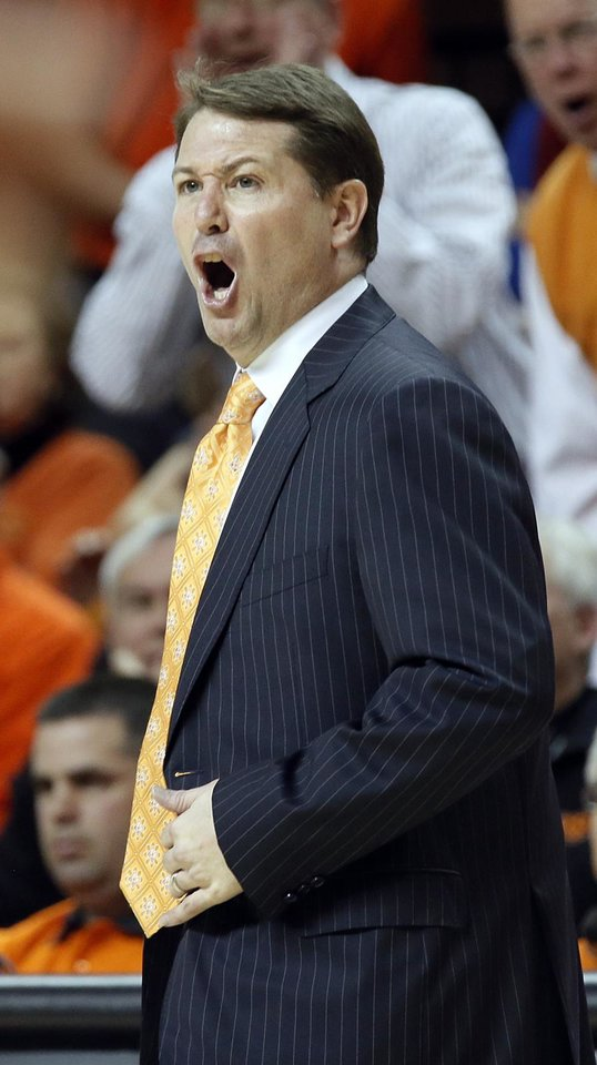 Travis Ford yells at the officials during the college basketball game between the Oklahoma State University Cowboys (OSU) and the University of Kanas Jayhawks (KU) at Gallagher-Iba Arena on Wednesday, Feb. 20, 2013, in Stillwater, Okla. Photo by Chris Landsberger, The Oklahoman