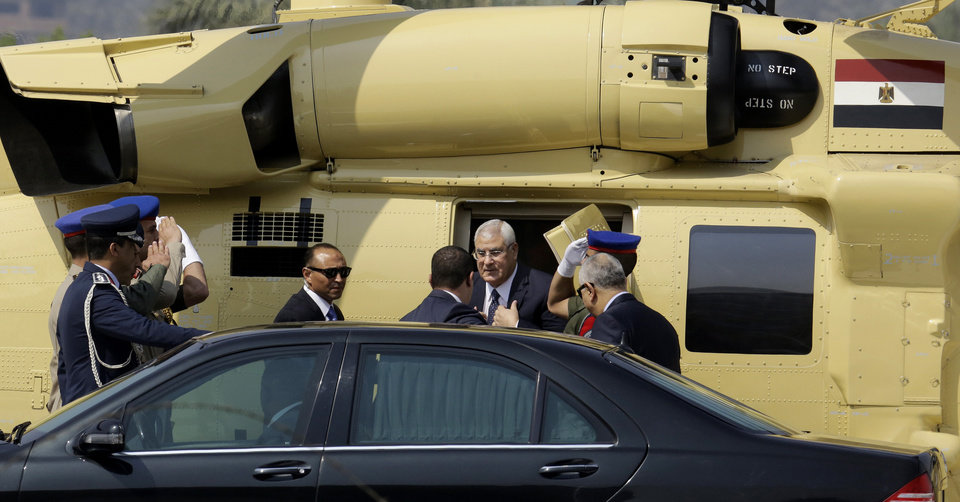 Photo - Egyptian outgoing interim President Adly Mansour gets out of a military helicopter upon his arrival at the Supreme Constitutional Court, in Cairo, Egypt, Sunday, June 8, 2014. Egypt's former army chief Abdel-Fattah el-Sissi was sworn in on Sunday as president for a four-year term, taking the reins of power in a nation roiled since 2011 by deadly unrest and economic woes. (AP Photo/Amr Nabil)