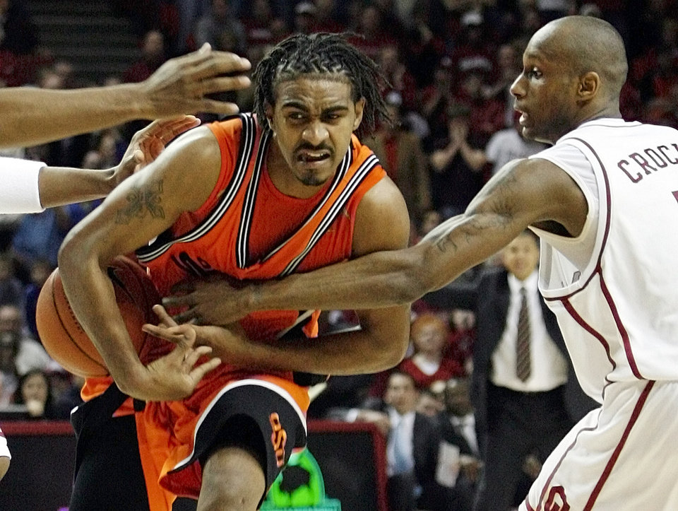 Photo - OU's Tony Crocker (5) knocks the ball away from OSU's JamesOn Curry (24) in the second half during the bedlam men's college basketball game between the University of Oklahoma Sooners and the Oklahoma State University Cowboys at Lloyd Noble Center in Norman, Okla., Wednesday, Feb. 7, 2007. OU won, 67-60. By Nate Billings, The Oklahoman  ORG XMIT: KOD