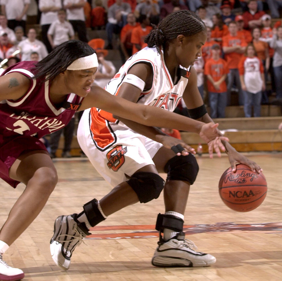 Photo - BEDLAM WOMEN'S COLLEGE BASKETBALL: Rosalind Ross of OU tries to steal the ball from Chantoya Hawkins of OSU.