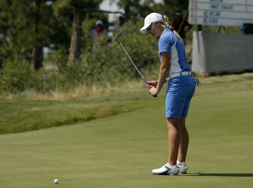 Photo - Europe's Charley Hull, from England, misses a birdie putt on the eighth hole during her singles match against United States' Paula Creamer at the Solheim Cup golf tournament on Sunday, Aug. 18, 2013, in Parker, Colo. (AP Photo/Chris Carlson)