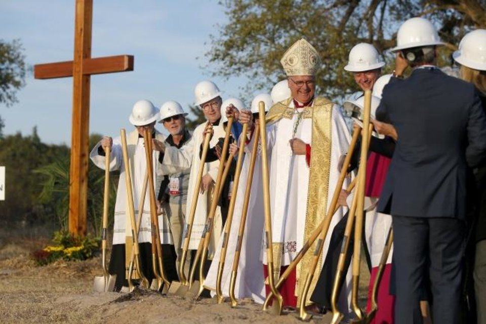 Photo -  The Most Rev. Paul S. Coakley, archbishop of the Roman Catholic Archdiocese of Oklahoma City, stands beside Oklahoma City Mayor David Holt with other clergy and dignitaries during a groundbreaking for the Blessed Stanley Rother Shrine. [Bryan Terry/The Oklahoman]