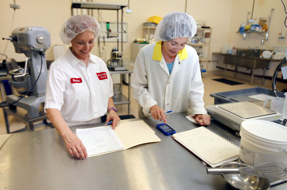 Vanessa Pry (left) and Renee Alberson-Nelson work in the baking area at OSU's Robert M. Kerr Food & Agricultural Products Center on the campus of Oklahoma State University in Stillwater, OK, Thursday, June 28, 2012,  By Paul Hellstern, The Oklahoman